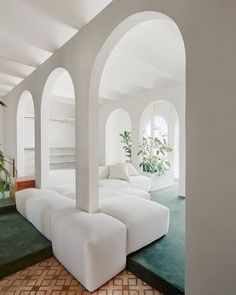 Partitions punctuated with arched openings divide the living spaces inside this Barcelona penthouse by architecture studio PMAA. Arch Interior, Modern Interior Design, Interior Architecture, Interior And Exterior, Victorian Architecture, Design Interiors, Exterior Colors, Luxury Interior, Appartement New York