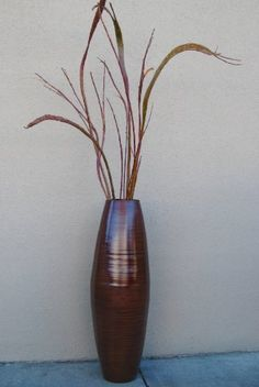 48 in. Tall Cylinder Floor Vase and Fantail Willow by Green Floral Crafts, http://www.amazon.com/dp/B007MSEI7E/ref=cm_sw_r_pi_dp_MuiAqb0QWEVWD