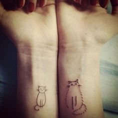 Simple Geometric Tattoos | Two cute, simple drawings of cats become fun wrist tattoos