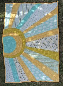 Like the idea of the sun and rays - I see it in golden batiks....with the sun perhaps placed lower in the quilt