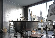 All the space around this free standing tub! Wonderful idea.