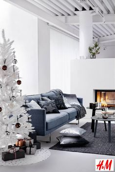 H&M Christmas Collection 2013: Hennes & Mauritz Modern #Christmas Living room with Christmas Decorations as Pillows, Plaids and Christmas Tree Ornaments in White, Grey, Silver and Black. (Photo #HM)
