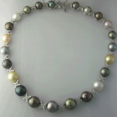 Gregg Ruth 18kt white gold black tahitian pearl and diamond X necklace   18kt White gold and multi-color tahitian pearl