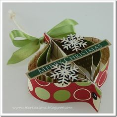 Christmas ornaments from paper - would be great with sheet music, maps, or book pages
