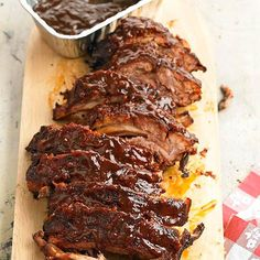 These ribs smothered in a sweet-spicy rub and thick tomato-molasses sauce will wow your guests. More grilling recipes: http://www.bhg.com/recipes/grilling/best-grilling-recipes/?socsrc=bhgpin070613kansascityribs=2