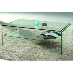 Dimensions: L1200xD600xH430mmThe Geraldine coffee table with a single glass shelf is great for displaying books or magazines in your living area. Its curved edges create a contoured, sleek finish.