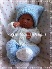 "4 piece set to fit a premature baby or 14"" reborn. Hat, booties, cardigan and pants ."