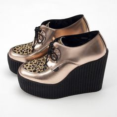 Underground Rose Gold Wedge Creepers  £130.00  This wedge creeper shoes by Underground has been made with leather upper and a ridged sole, exclusively available at 3939 SHOP, London. It features a Leopard paneled design with lace-up closure to the front, an almond shaped toe, a high platform sole and a chunky wedge heel.