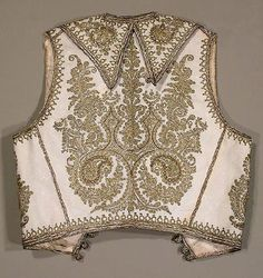 Late-Ottoman embroidered childs vest (the back of it). Gold thread embroidery on white felt; technique: 'kordon tutturma' (= applied cord). Ca. 1880-1900. Probably from the Balkans.