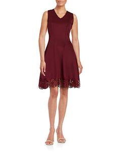 """<ul> <li>Body-hugging flared knit textured with a crochet hem</li> <li>V neck</li> <li>Sleeveless</li> <li>Concealed back zipper closure</li> <li>Princess seams</li> <li>Crochet hem</li> <li>About 38"""" from shoulder to hem</li> <li>Polyester/spandex</li> <li>Dry clean</li> <li>Imported</li> <li>This item ..."""