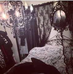 Gothic bedroom - black and white, with some colours in between.