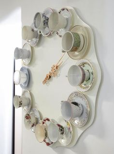 Teacups Clock; repurpose tea cups and saucers as the numbers for a giant clock. I LOVE this!