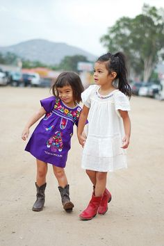 @jegillette  -- older sis with long hair & red boots, little sis with bobbed hair & black boots...this was so us!