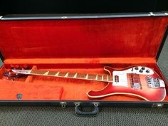 Vintage 1971 FireGlo Rickenbacker 4001 Bass Guitar in SUPER clean All original condition with the Original Hard Shell CaseThe Fireglo finish has a really beautiful and unusual figure in the maple on the left side. There is some birdseye and flame all mixed together there and it carries thro... $4950
