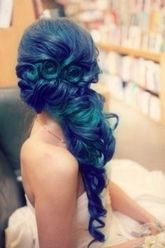 blue hair in curls and waves.