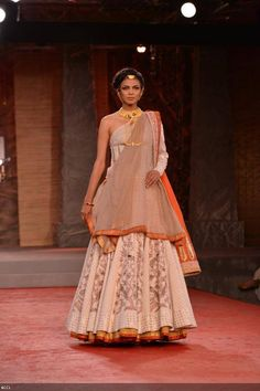 Nayanika Chatterjee walks the ramp for designer Anju Modi on Day 1 of Delhi Couture Week, held in New Delhi, on July 31, 2013.