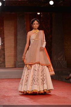 Nayanika Chatterjee walks the ramp for designer Anju Modi on Day 1 of Delhi Couture Week, held in New Delhi, on July 31, 2013.
