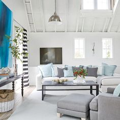 Tongue-and-groove walls and whitewashed oak floors in this living room create an appearance of age in keeping with the rest of the Idea Cottage. | Coastalliving.com