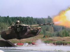 Badass picture of a tank firing in mid air. - Imgur