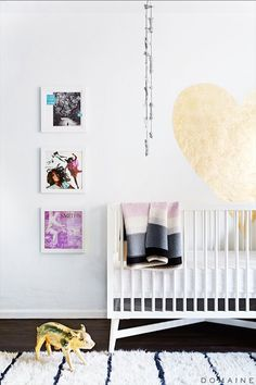 Adorable baby #nursery with gold wall art and #brass piggy bank