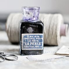 An antique French ink bottle with a Paris address on the label