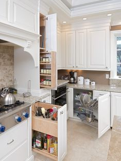 Pull-out cabinets with large utensil storage next to the stove; also, a baking sheet cabinet next to the stove instead of under it.