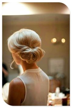 This messy updo is super chic for any bride. #bridalbeauty #weddinghair