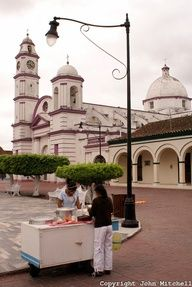 Ice cream vendor in the main plaza of the Spanish colonial river town of Tlacotalpan, Veracruz, MEXICO. San Cristobal parish church is in the background. Tlacotlapan was made a UNESCO World Heritage Site in 1998.