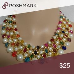 Multicolor glass pearl rhinestone bib necklace This is a brand new necklace.It is made with white glass pearl.It has a adjustable clasp Jewelry Necklaces