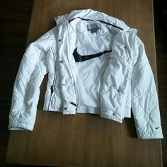 Womens Nike white puffer jacket Womens size xs (0-2) white super light amd warm perfect for gym or like that its very simple its very white has some tiny spots very hard to notice from regular wear and very little tiny hole 3rd pic so small its not noticeable back left arm ziper works perfect selling as is!! Nike Jackets & Coats Puffers