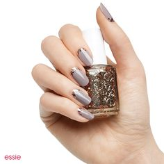 Reverse the classic french and add rich metallic glitter for wow factor. Fashionistas will flip for this fresh take on a timeless favorite.