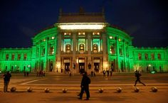 he Burgtheater is illuminated with green lights to celebrate St. Patrick's Day in Vienna, Austria on March 17