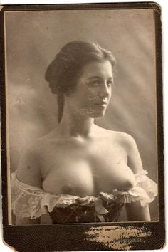 """Victorian Breasts by Wooway1 on Flickr """"A late cabinet card with the photographer obscured by paper which appears to have adhered after removal from a mat. I think this was a personal card based upon the lighting, pose and photographer identification on the mat. I would call this an art photograph as opposed to the genre of pornography. In fact I would call it fine art because what is finer than the female figure."""""""