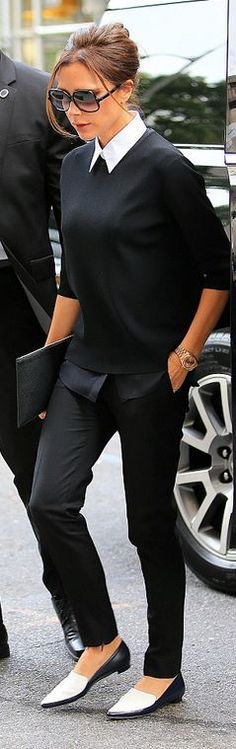 Who made Victoria Beckham's black pants, clutch handbag, white collar top, sweater, and watch?