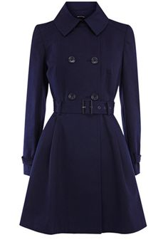 This classic coat is updated with a full skirt and double breasted fastenings. With a matching belt and a peter pan collar, this is the perfect piece for your transitional wardrobe.