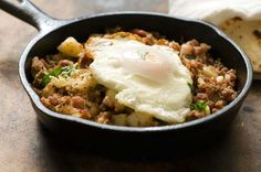 Corned beef hash with chipotle chiles and Irish bacon Recipe Breakfast and Brunch, Main Dishes with russet potatoes, vegetable oil, yellow onion, garlic, chipotle chile, corned beef, irish bacon, salt, pepper, chopped cilantro, large eggs, flour tortillas