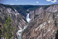 Yellowstone includes several mountain ranges, an enormous body of water (Yellowstone Lake), and a number of rivers and streams. The Grand Canyon of the Yellowstone is one of the most magnificent canyons in the United States.