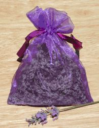 "Made in California's™ Lavender Sachet -  The sensual, soothing smell of lavender potpourri. When the scent starts to dull, simply press the sachet between your fingers to reactivate it. Place in drawers, closets, under your car seat, inside your shoes, use in a sleep pillow to encourage sleep. Also, a great substitute for moth balls..... or anywhere you want a pleasant scent. Sachet are a large 4""x 5.5"" organaza bag. (bag colors may be different slightly from picture) Lavender Sachets, Potpourri, Car Seat, Closets, Fingers, Moth, Balls, Drawers, Sleep"