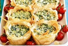 """To spinach and cheese we say """"yes please!"""", and if it also involves flaky filo, like these Greek-style pies, all the better! Try this recipe for an easy dinner or a spring picnic.Delicious and so simple! Quiche Recipes, Pastry Recipes, Pie Recipes, Appetizer Recipes, Cooking Recipes, Philo Dough, Vol Au Vent, Vegetarian Recipes, Healthy Recipes"""