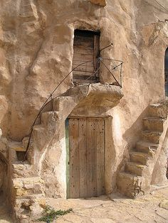 15th century Saharan granary chambers (ghorfas) encircling a courtyard in Tataouine, Tunisia