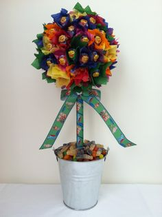 Rainbow coloured chupa chup Lolly tree, with 'in the night garden' ribbon.