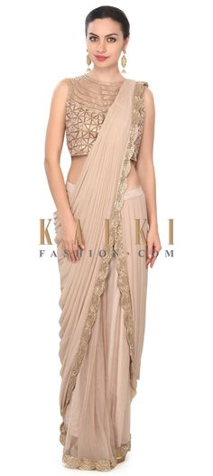Buy This Beige saree gown adorn in embroidered border only on Kalki