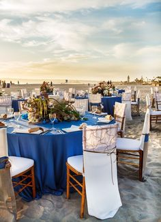 Beautiful reception tables at the beach.  Love the blue and white!