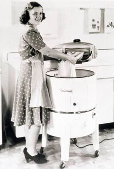This is the kind of washer we had when I was a little girl.  The top part is a wringer that the clothes had to be put through to press out the water. It hooked up to the kitchen faucet.