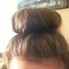 Messy sock bun on top of head