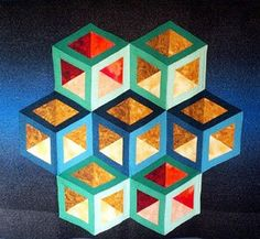 Inner Glow Quilt Pattern This quilt is striking as well as beautiful! The quil… Inner Glow Quilt Pattern This quilt Patchwork Quilt, 3d Quilts, Hexagon Quilt, Barn Quilts, Triangle Quilts, Triangles, Tumbling Blocks Quilt, Quilt Blocks, Quilting Projects