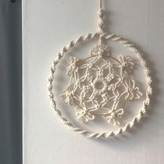 Image may contain: jewelry Macrame Knots, Micro Macrame, Hobbies And Crafts, Diy And Crafts, Handmade Christmas, Christmas Crafts, Circular Weaving, Crochet Wreath, Weaving Wall Hanging