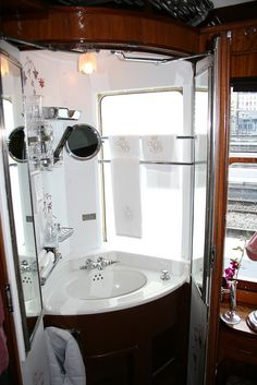 Venice Simplon Orient Express. Restored 1920s era luxury sleeping compartments feature period amenities like this vanity cabinet.