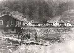 Federal troops patrolling Blair, WV in September 1921 following the Battle of Blair Mountain between  miners and Sheriff Chafin's army. Notice the houses, they are old coal camp houses