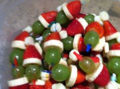 Grinch Kabobs. Layer mini marshmallow, strawberry, banana and grape on a toothpick